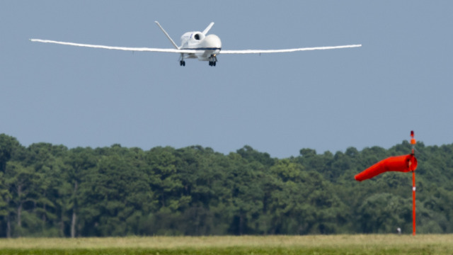A NASA Global Hawk drone aircraft, in flight during a Hurricane and Severe Storm Sentinel, or HS3, mission