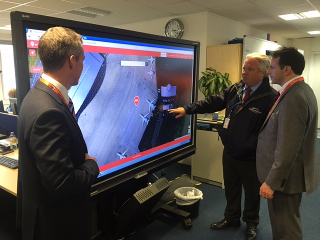 Earth-i CEO, Richard Blain (right) and Farnborough International Head of Operational Development & Health and Safety, Jonathan Smith (middle) use the mapping tool created for Farnborough 2016