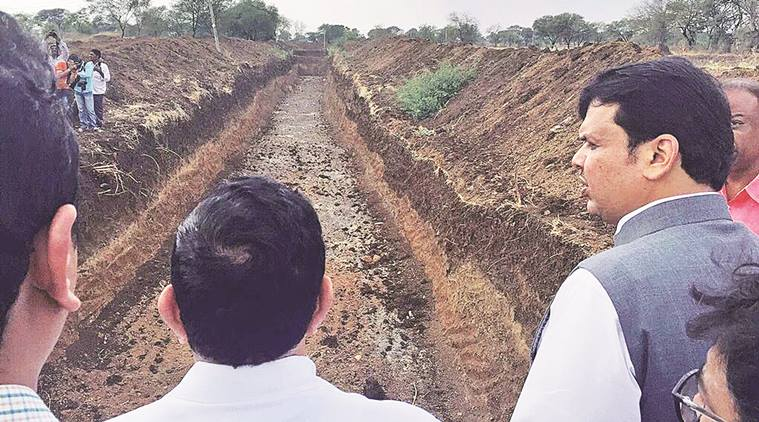 Chief minister Devendra Fadnavis (on right) reviewing the Jalyukta Shivar project in district of Maharashtra