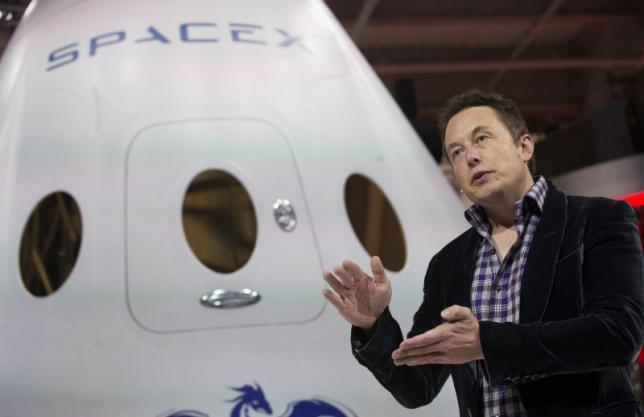 SpaceX CEO Elon Musk speaks after unveiling the Dragon V2 spacecraft in Hawthorne, California May 29, 2014.