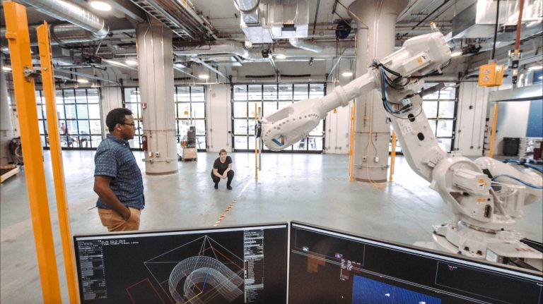 A research team in the Autodesk BUILD Space explores human-robot interaction.