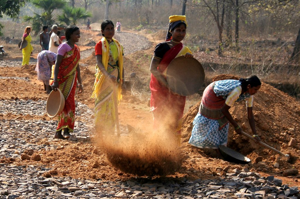 Labours or workers are working on a Road under NREGA at Dantewada District in Chhattisgarh on 28/3/2009. The National Rural Employment Guarantee Act or NREGA is an Indian job guarantee scheme, enacted by legislation on August 25, 2005. The scheme provides a legal guarantee for one hundred days of employment in every financial year to adult members of any rural household willing to do public work-related unskilled manual work at the statutory minimum wage of Rs.60 per day. The Central government outlay for scheme is Rs. 39,100 crores ($8 billion) in FY 2009-10. Photo by Shailendra Pandey/Tehelka.
