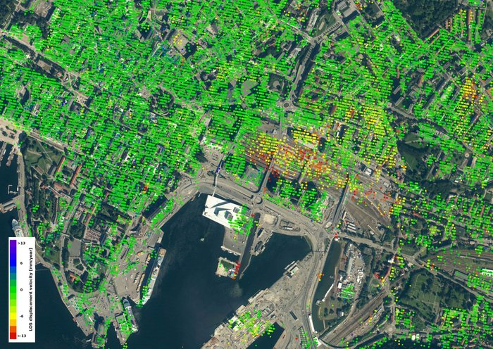 Data from the Sentinel-1 satellites acquired between 26 December 2014 and 28 October 2016 show that parts of the Oslo train station are sinking by 10–15 mm a year in the 'line of sight' – the direction that the satellite is 'looking' at the building. This translates into a vertical subsidence of 12–18 mm a year. It can also be observed that the new opera house – the white structure located by the fjord south of the subsiding area – has not moved.