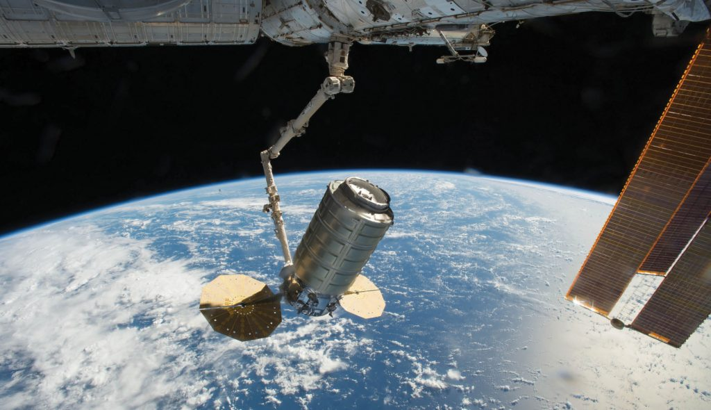 The International Space Station's Canadarm2 robotic arm captures Orbital ATK's Cygnus cargo spacecraft