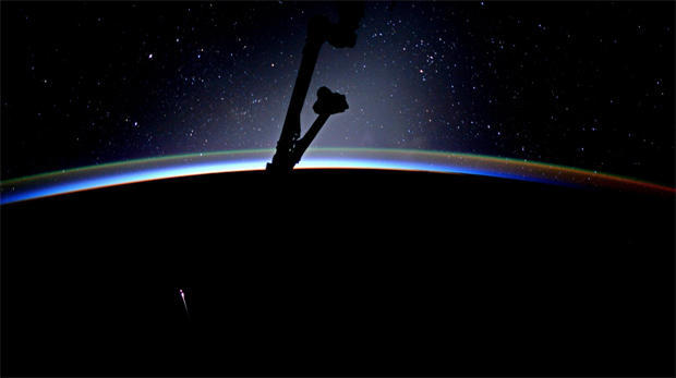 American astronaut Jack Fischer releases the hatch holding Dragon to the International Space Station.