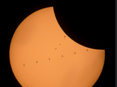 NASA astronauts get captured on camera as photo editor records total solar eclipse
