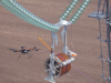 Drones are replacing helicopters in pulling transmission lines