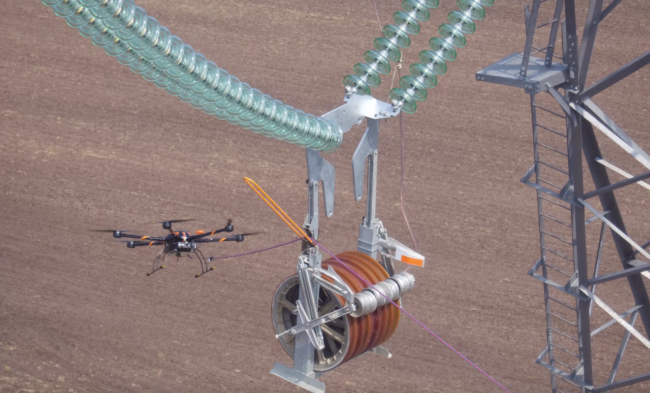 Drones are replacing helicopters in pulling transmission lines.