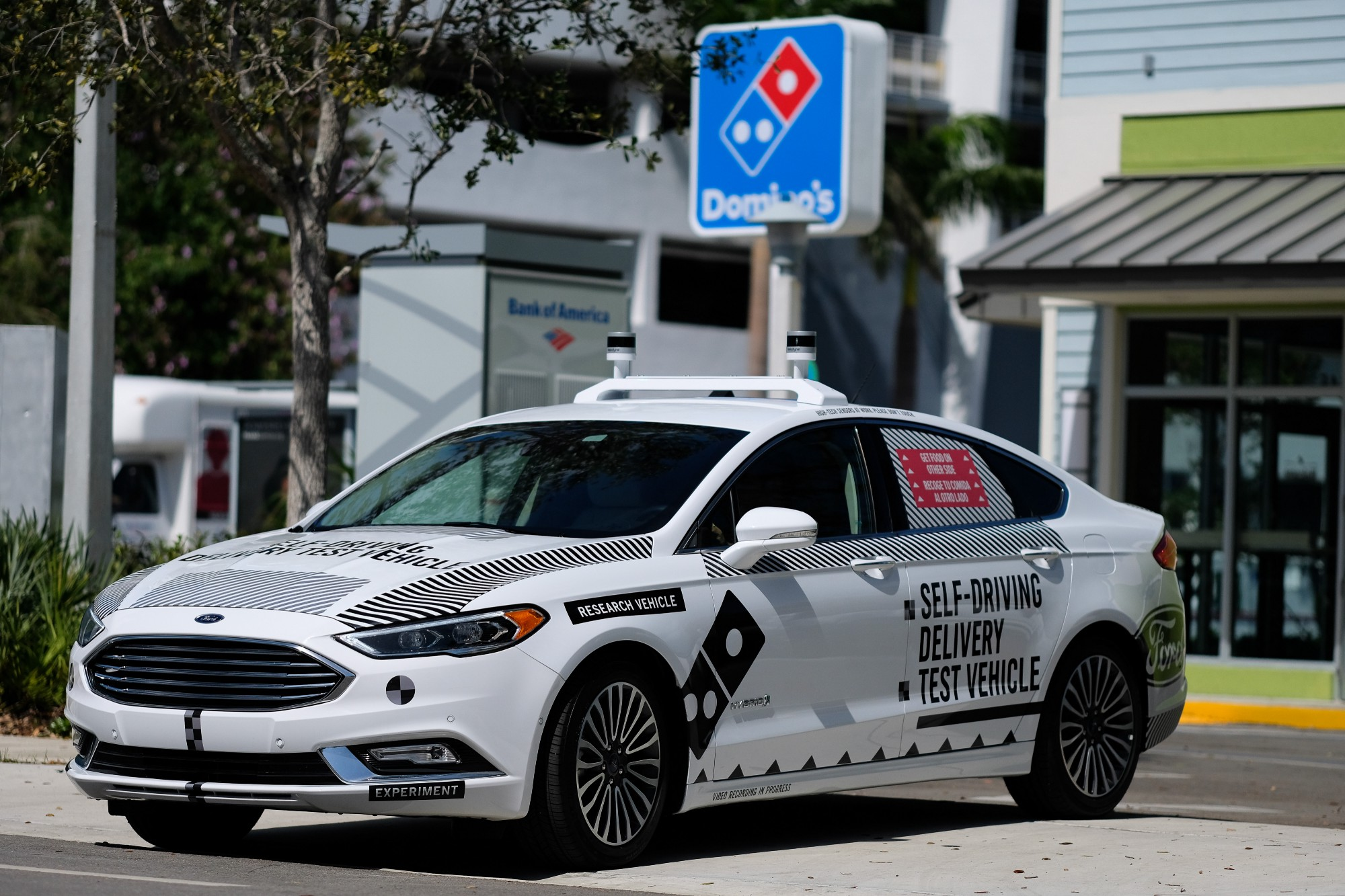 Ford partners with Domino's and Postmates on self-driving car project