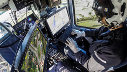 The UK National Police Air Service (NPAS) mission crew use CarteNav's AIMS-ISR software on an aerial surveillance mission.