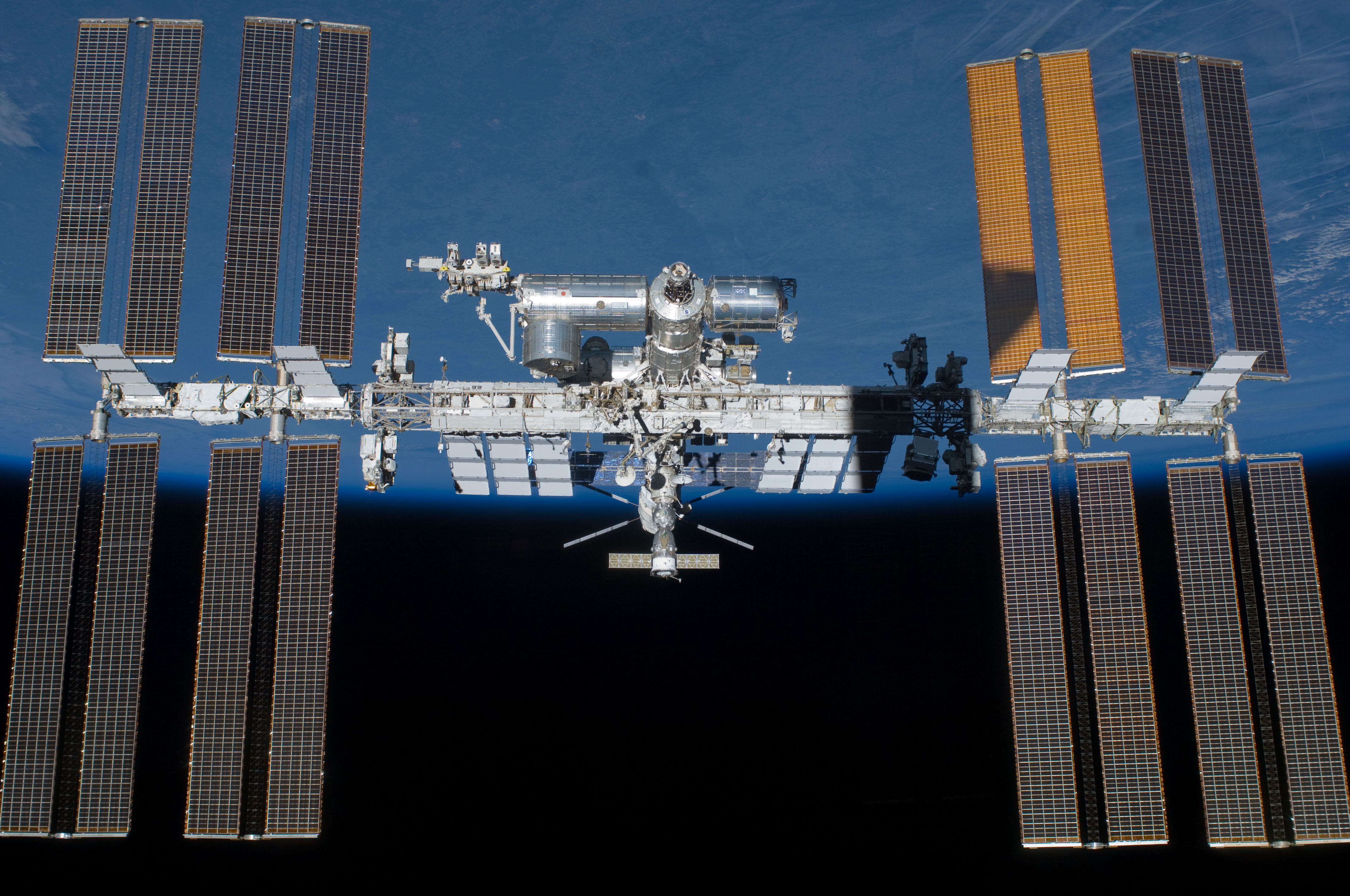 Astronauts repairing air leak on International Space Station